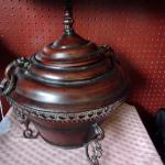 Heavy decorated footed pot with cover hinged chain