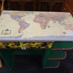 child's desk with map of the world